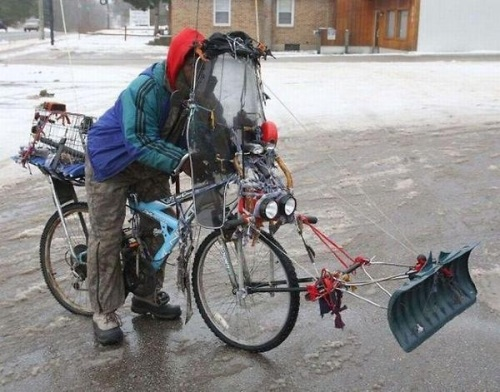 Man on Bicycle Snow Plow